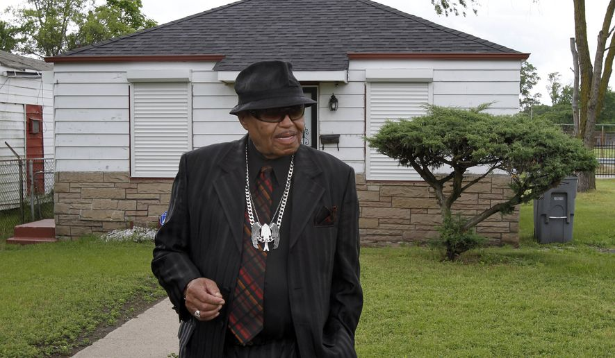 In this June 2, 2010, file photo, Joe Jackson tours the his family home in Gary, Ind.  Joe Jackson, the patriarch of America's most famous musical clan has died, says a family source on Wednesday, June 27. He was 89. (AP Photo/John Smierciak, File)