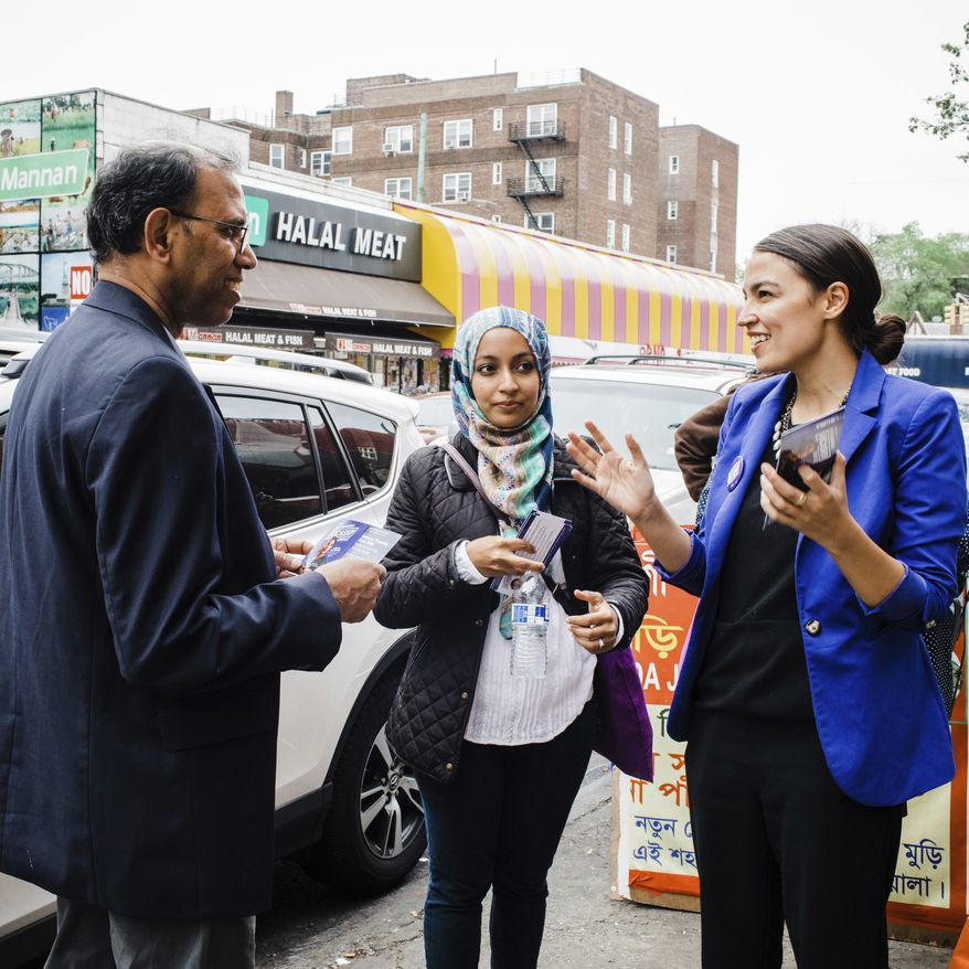 This May 6, 2018, file photo provided by the Alexandria Ocasio-Cortez Campaign shows candidate Alexandria Ocasio-Cortez, right, during a Bengali community outreach in New York. Ocasio-Cortez, a 28-year-old political novice running on a low budget and an unabashedly liberal platform, upset longtime U.S. Rep. Joseph Crowley on Tuesday in the Democratic congressional primary in New York. (Corey Torpie/Courtesy Alexandria Ocasio-Cortez Campaign via AP)