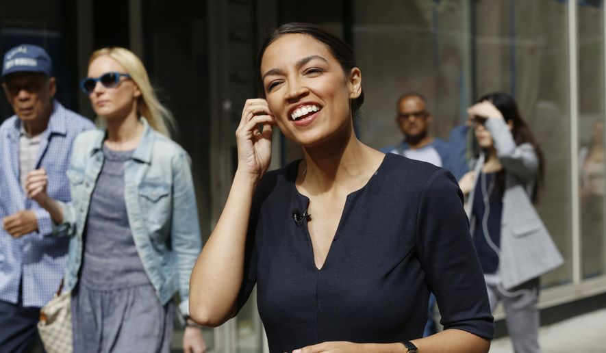 Alexandria Ocasio-Cortez, the winner of a Democratic Congressional primary in New York, talks to the media, Wednesday, June 27, 2018, in New York. Ocasio-Cortez, 28, upset U.S. Rep. Joe Crowley in Tuesday's election. (AP Photo/Mark Lennihan)