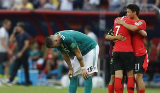 Germany's Niklas Suele, left, is dejected as South Korea's Son Heung-min, right, celebrates after the group F match between South Korea and Germany, at the 2018 soccer World Cup in the Kazan Arena in Kazan, Russia, Wednesday, June 27, 2018. South Korea won the match 2-0. (AP Photo/Frank Augstein) **FILE**