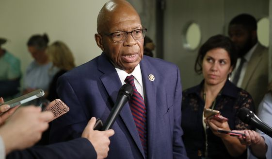 Rep. Elijah Cummings, D-Md., speaks as he departs a deposition before the House Judiciary Committee by Peter Strzok, the FBI agent facing criticism following a series of anti-Trump text messages, on Capitol Hill, Wednesday, June 27, 2018 in Washington. (AP Photo/Alex Brandon)