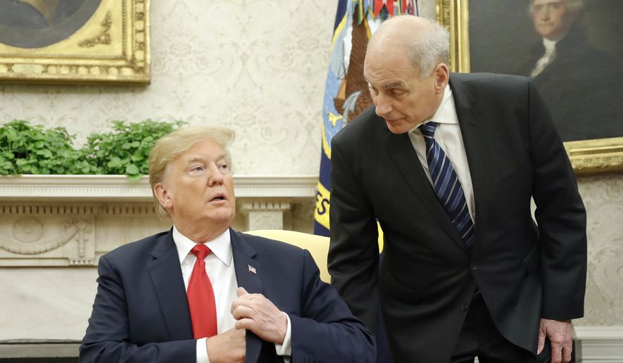 White House Chief of Staff John Kelly, right, leans in to talk with President Donald Trump during Trump's meeting with Portuguese President Marcelo Rebelo de Sousa, in the Oval Office of the White House in Washington, Wednesday, June 27, 2018. (AP Photo/Pablo Martinez Monsivais)