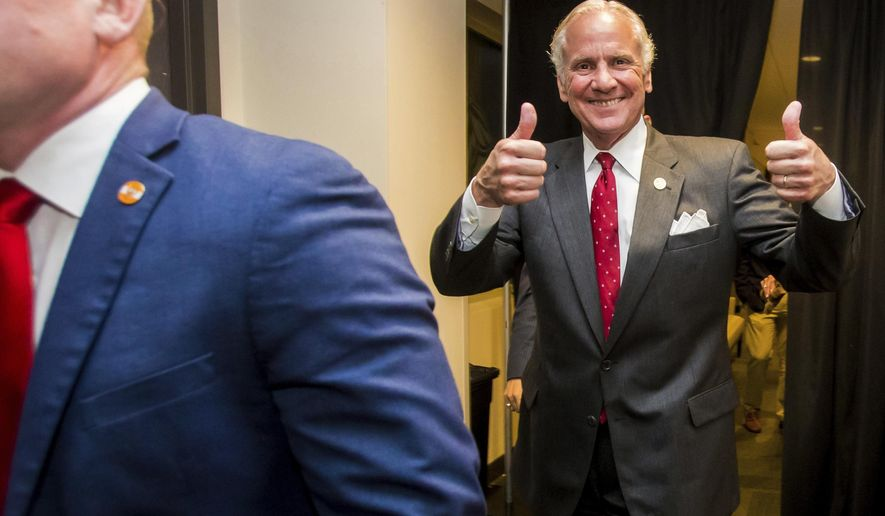 Following his victory in the primary runoff election, South Carolina Gov. Henry McMaster leaves his suite at Spirit Communications Park and heads to the podium speak at his victory party, Tuesday, June 26, 2018, in Columbia, S.C. (Jeff Blake/The State via AP)