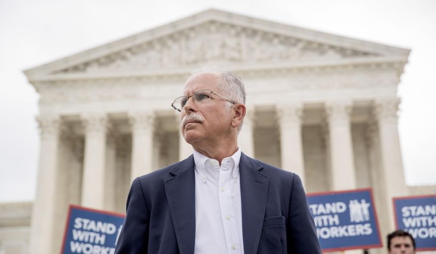 Plaintiff Mark Janus stands outside the Supreme Court after the court rules in a setback for organized labor that states can't force government workers to pay union fees, Wednesday, June 27, 2018, in Washington. (AP Photo/Andrew Harnik) **FILE**