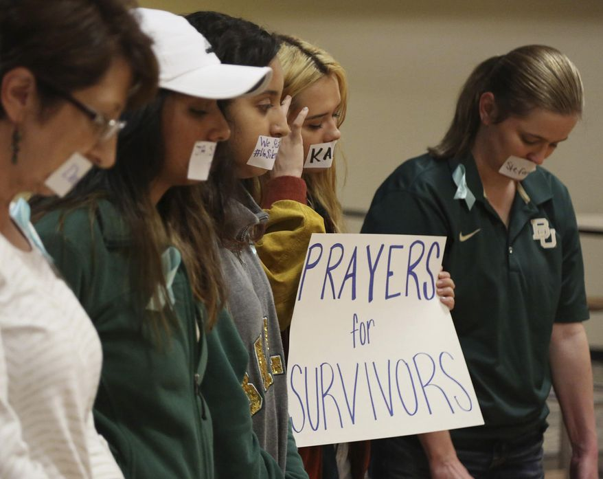 FILE - In this June 3, 2016 file photo, current and former Baylor students hold a rally warning of sexual assaults on and off campus in Waco, Texas. A former athletic director at Baylor University, Ian McCaw, has claimed regents schemed to make black football players scapegoats for a decades-long problem of sexual assault at the school. Excerpts taken from McCaw's June 19 deposition appear in documents filed Wednesday in a federal lawsuit pending against Baylor. Ten women are suing the school over how it handled their allegations of sexual assault. (Rod Aydelotte/Waco Tribune Herald via AP, File)