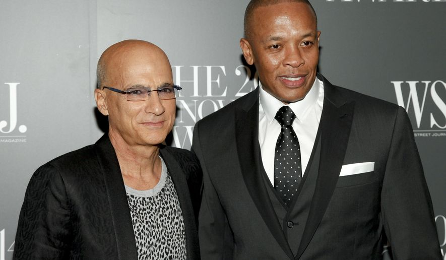 FILE - In this Nov. 5, 2014 file photo, Jimmy Iovine, left, and Dr. Dre, right, attend the WSJ. Magazine 2014 Innovator Awards in New York. A jury has found that Dr. Dre, music mogul Jimmy Iovine and their headphone company Beats Electronics owe a former partner $25.2 million in royalties. (Photo by Andy Kropa/Invision/AP, File)
