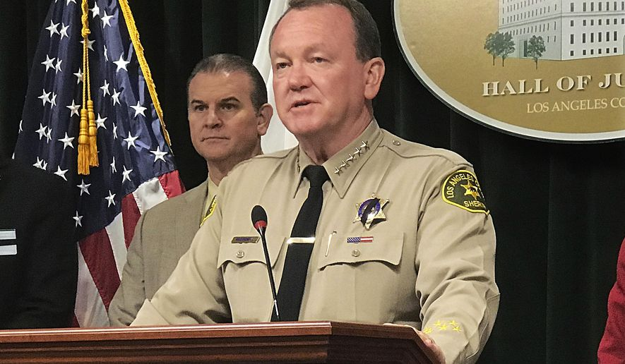 Los Angeles County Sheriff Jim McDonnell talks to reporters about the case of a 10-year-old boy who died after suffering head injuries, and previously claimed he was beaten, locked up and not fed, at a news conference at the Hall of Justice in Los Angeles, Wednesday, June 27, 2018. The boy, Anthony Avalos, made the allegations in private interviews conducted after the Department of Children and Family Services received one of a dozen referrals over several years involving the boy, who died June 21, 2018, at a hospital in Lancaster, Calif. Anthony's mother, Heather Barron, and her boyfriend, Kareem Leiva, have not been charged with any crimes related to the child's death. (AP Photo/Michael Balsamo)