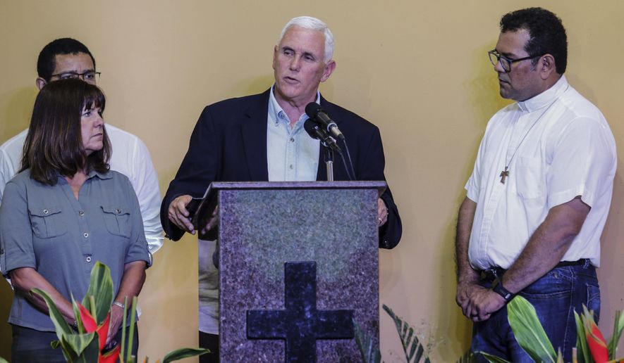 U.S. Vice President Mike Pence, center, accompanied by his wife Karen, left, speaks after a meeting with Venezuelan families at the Santa Catarina migrant shelter, in Manaus, Brazil, Wednesday, June 27, 2018. U.S. Vice President Mike Pence has arrived in Brazil for a Latin American trip expected to focus on the deteriorating humanitarian situation in Venezuela. (AP Photo/Marcio Melo)