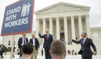 CORRECTS LEFT TO RIGHT - Illinois Gov. Bruce Rauner gives a thumbs up outside the Supreme Court, Wednesday, June 27, 2018 in Washington. From left are, Liberty Justice Center's Director of Litigation Jacob Huebert, plaintiff Mark Janus, Rauner, and Liberty Justice Center founder and chairman John Tillman.  The Supreme Court ruled Wednesday that government workers can't be forced to contribute to labor unions that represent them in collective bargaining, dealing a serious financial blow to organized labor.   (AP Photo/Andrew Harnik)