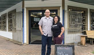 ADVANCE FOR WEEKEND USE JUNE 30-JULY 1, 2018 AND THEREAFTER In this Monday, June 18, 2018 photo, John and Veronica Avila stand in front of Henderson & Kane General Store in Houston. Their store only recently opened its doors and will mark its grand opening on July Fourth when the Sixth Ward is crowded with folks catching the fireworks over Eleanor Tinsley Park and Sam Houston Park. (J.C. Reid/Houston Chronicle via AP)