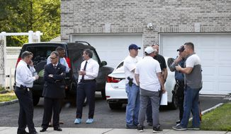 In this June 26, 2018 photo, Bergen County Prosecutors Office and Sheriff's Department investigate a body found in the home of Giants cornerback Janoris Jenkins in Fair Lawn, N.J. Authorities have identified the dead man as Roosevelt Rene, a family friend of Jenkins. (Aristide Economopoulos/The Star-Ledger via AP)