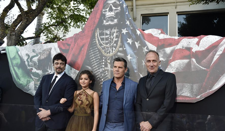 """Stefano Sollima, right, director of """"Sicario: Day of the Soldado,"""" poses with cast members, from left, Benicio Del Toro, Isabela Moner and Josh Brolin at the premiere of the film at the Westwood Regency Theatre, Tuesday, June 26, 2018, in Los Angeles. (Photo by Chris Pizzello/Invision/AP)"""