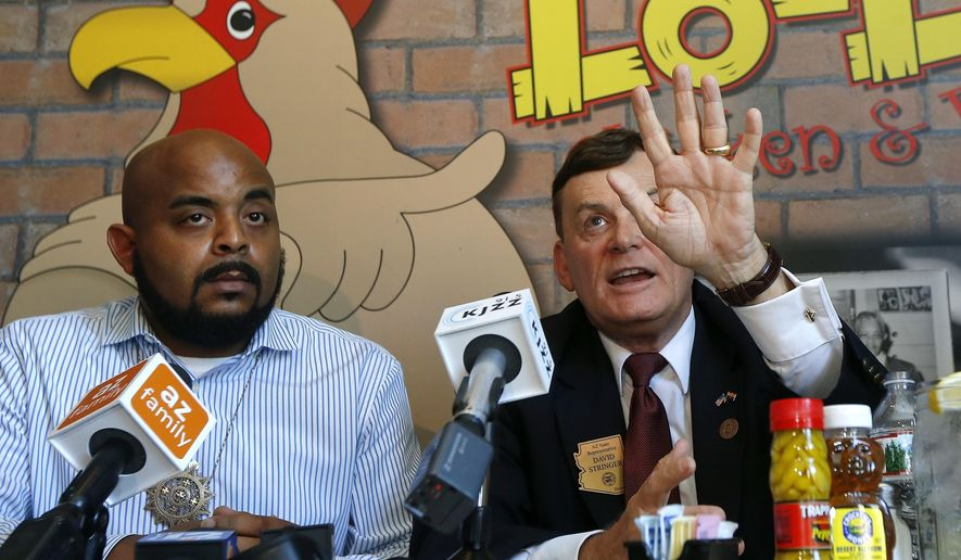"Arizona Rep. David Stringer, R-Prescott, right, speaks at a community forum to explain his recent immigration remarks, with Rev. Jarrett Maupin, left, and other community members at a local restaurant Wednesday, June 27, 2018, in Phoenix. Stringer was videotaped earlier this month saying immigration is an ""existential threat"" to the United States among other comments. (AP Photo/Ross D. Franklin)"