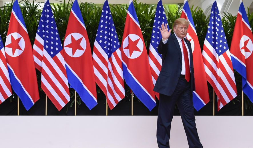 FILE - In this June 12, 2018, file photo, U.S. President Donald Trump waves after saying goodbye to North Korea leader Kim Jong Un at the Capella resort on Sentosa Island in Singapore. Trump says the Singapore summit put North Korea on a path to eliminating its nuclear weapons. If that proves true, then it also may have poked a hole in the Pentagon's main argument for a multibillion-dollar expansion of missile defense. Although uncertainty remains over North Korea's intentions, if it does disarm, then Congress may see less logic to spending $6 billion or more to expand a missile defense system based in Alaska. (AP Photo/Susan Walsh, Pool)