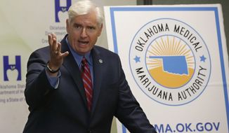 Tom Bates, Oklahoma's interim health commissioner, speaks during a news conference in Oklahoma City, Wednesday, July 27, 2018. Bates said the state's Department of Health will be ready to implement a new law allowing medical marijuana. (AP Photo/Sue Ogrocki)