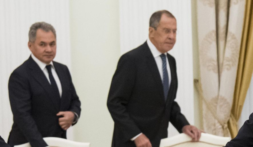 Russian President Vladimir Putin, left, shakes hands with U.S. National security adviser John Bolton with Russian Defense Minister Sergei Shoigu, and Russian Foreign Minister Sergey Lavrov in the background, during their meeting in the Kremlin in Moscow, Russia, Wednesday, June 27, 2018. Bolton is meeting Putin for talks intended to set the stage for a U.S.-Russia summit. (AP Photo/Alexander Zemlianichenko, Pool)