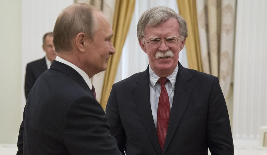 Russian President Vladimir Putin, left, invites U.S. National security adviser John Bolton for the talks during their meeting in the Kremlin in Moscow, Russia, Wednesday, June 27, 2018. U.S. President Donald Trump's national security adviser is due in Moscow Wednesday to lay the groundwork for a possible U.S.-Russia summit. (AP Photo/Alexander Zemlianichenko, Pool)