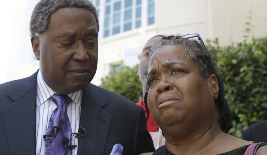 Brigett McIntyre discusses the federal lawsuit filed against two Sacramento area law enforcement agencies over the 2017 shooting death of her son, Mikel McIntyre, Wednesday, June 27, 2018, in Sacramento, Calif. Attorney John Burris, left, filed the suit against the Sacramento County Sheriff's Department and Rancho Cordova Police Department alleging that officers fatally shot McIntyre as he ran away and that the agencies have failed to provide details of the shooting more than a year later. (AP Photo/Rich Pedroncelli)