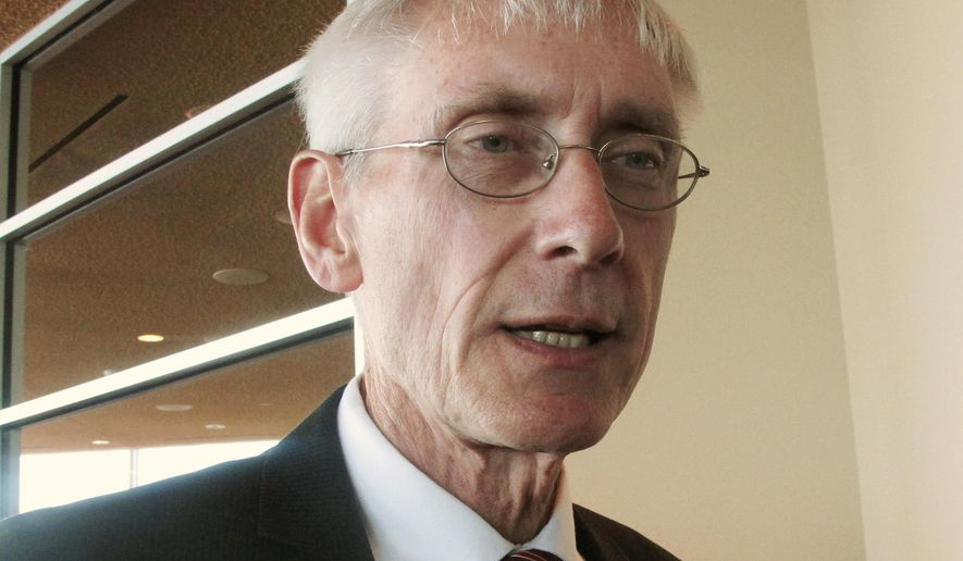 FILE - In this March 15, 2017, file photo, Wisconsin School Superintendent Tony Evers talks with reporters in Madison, Wis. The Wisconsin Supreme Court has sided with the state Superintendent, saying he can hire his own attorney instead of being represented by the state Department of Justice in a lawsuit challenging his authority. The case hangs heavy with political implications as Evers is running for governor to challenge Republican Gov. Scott Walker. (AP Photo/Scott Bauer, File)