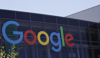 This July 19, 2016, file photo shows the Google logo at the company's headquarters in Mountain View, Calif. (AP Photo/Marcio Jose Sanchez, File)