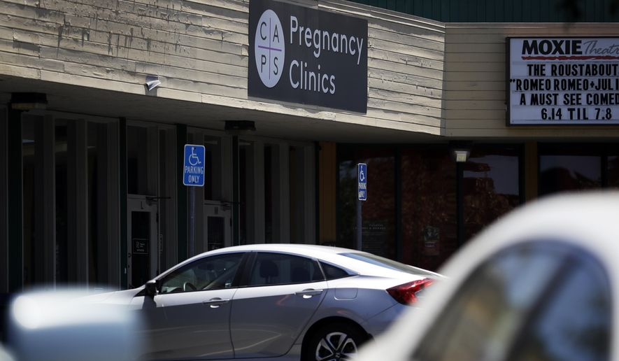 A College Area Pregnancy Services (CAPS) clinic is seen Tuesday, June 26, 2018, in San Diego. The Supreme Court on Tuesday effectively put an end to a California law that forces anti-abortion crisis pregnancy centers to provide information about abortion. (AP Photo/Gregory Bull)