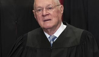 FILE - In this June 1, 2017, file photo, Supreme CourtAssociate Justice Anthony M. Kennedy joins other justices of the U.S. Supreme Court for an official group portrait at the Supreme Court Building in Washington. The 81-year-old Kennedy said Tuesday, June 27, 2018, that he is retiring after more than 30 years on the court.(AP Photo/J. Scott Applewhite, File)