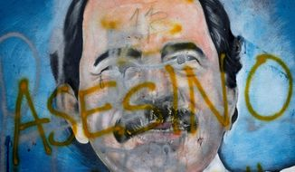 "The Spanish word for ""Murderer"" covers a mural of Nicaraguan President Daniel Ortega as part of anti-government protests. On July 5, 2018, the Trump administration announced it was levying Magnitsky Act sanctions against three members of the Ortega regime, citing human-rights abuses. (Associated Press/File) **FILE**"
