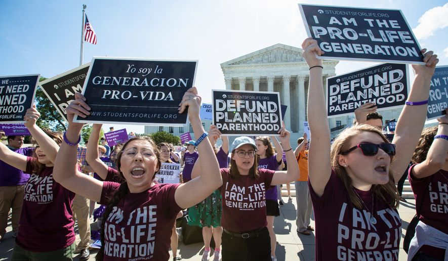 Pro-life and anti-abortion advocates demonstrate in front of the Supreme Court early Monday, June 25, 2018. The justices are expected to hand down decisions today as the court's term comes to a close. (AP Photo/J. Scott Applewhite) **FILE**