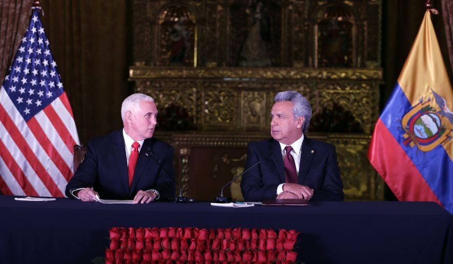 U.S. Vice President Mike Pence, left, and Ecuador's President Lenin Moreno exchange looks during the delivery of a final statement at the government palace in Quito, Ecuador, Thursday, June 28, 2018. (AP Photo/Dolores Ochoa)