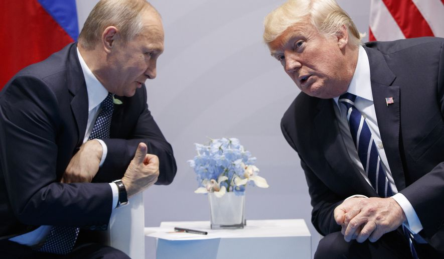 FILE - In this Friday, July 7, 2017, file photo U.S. President Donald Trump meets with Russian President Vladimir Putin at the G-20 Summit in Hamburg.  The Kremlin and the White House have announced Thursday June 28, 2018, that a summit between Russian President Vladimir Putin and U.S. President Donald Trump will take place in Helsinki, Finland, on July 16. (AP Photo/Evan Vucci, FILE)