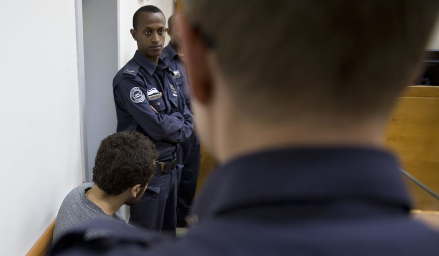 In this April 20, 2017 photo, dual U.S.-Israeli citizen, Michael Ron David Kadar, sits during a court session, in Rishon Lezion, Israel. An Israeli court on Thursday, June 28, 2018, convicted Kadar, for making a string of bomb threats targeting U.S. Jewish community centers, airlines and shopping malls -- capping a case that had raised fears of a wave of anti-Semitism in the United States. (AP Photo/Sebastian Scheiner)