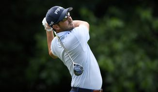 Andrew Landry watches his tee shot from the 16th tee during the first round of the Quicken Loans National golf tournament, Thursday, June 28, 2018, in Potomac, Md. (AP Photo/Nick Wass)