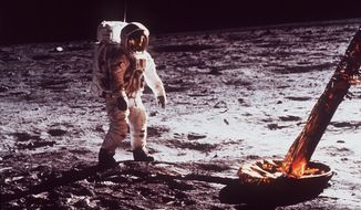 "Astronaut Edwin ""Buzz"" Aldrin walks by the footpad of the Apollo 11 Lunar Module, July 1969. (AP Photo/NASA)"