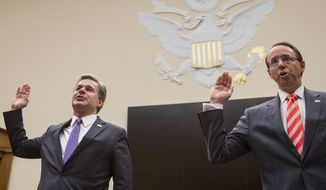 Deputy Attorney General Rod Rosenstein, right, and FBI Director Christopher Wray, left, are sworn in to testify before a House Judiciary Committee hearing on Capitol Hill in Washington, Thursday, June 28, 2018, on Justice Department and FBI actions around the 2016 presidential election. (AP Photo/Andrew Harnik)