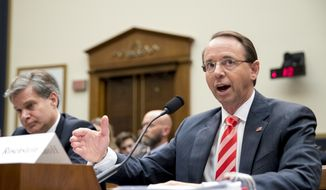 Deputy Attorney General Rod Rosenstein, right, accompanied by FBI Director Christopher Wray, left, testifies before a House Judiciary Committee hearing on Capitol Hill in Washington, Thursday, June 28, 2018, on Justice Department and FBI actions around the 2016 presidential election. (AP Photo/Andrew Harnik)