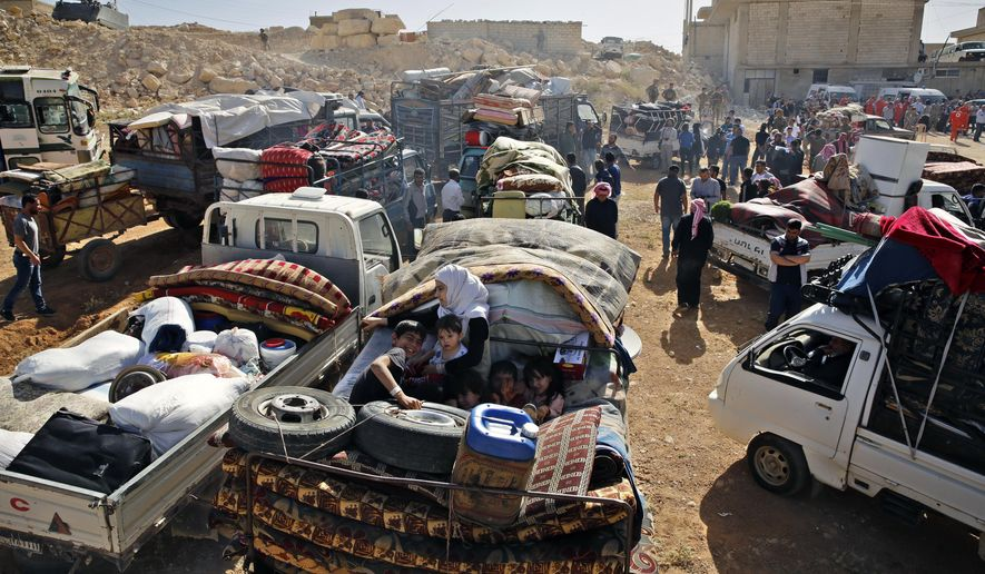 Syrian refugees gather in their vehicles getting ready to cross into Syria from the eastern Lebanese border town of Arsal, Lebanon, Thursday, June 28, 2018. About 400 Syrians are expected to make the crossing on Thursday, after having requested permission from the Lebanese and Syrian governments. (AP Photo/Bilal Hussein)