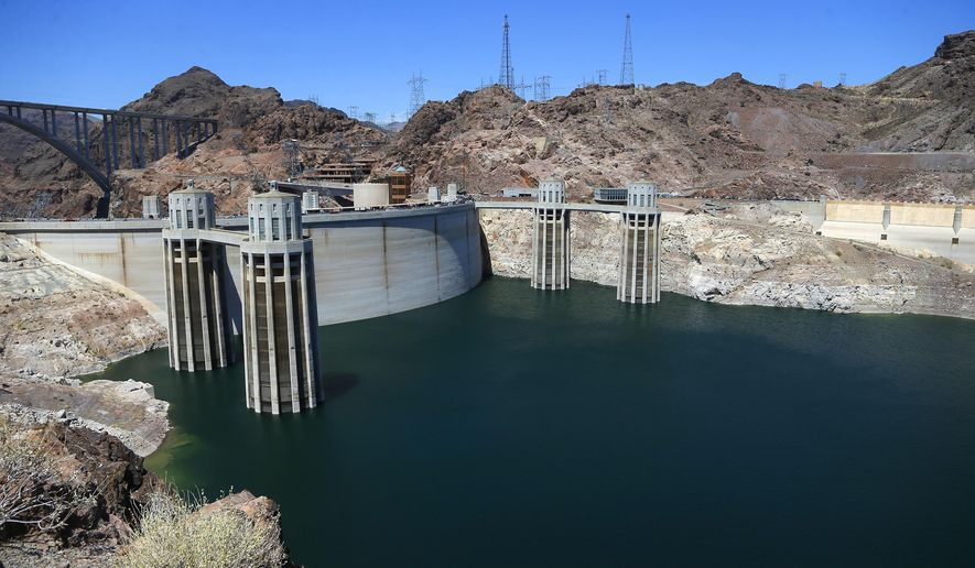 The low level of the water line is shown on the banks of the Colorado River at the Hoover Dam Thursday, May 31, 2018, in Hoover Dam, Ariz. Arizona is renewing a focus on a drought contingency plan for the shrinking supply of Colorado River water, and other Western states are paying close attention. (AP Photo/Ross D. Franklin)