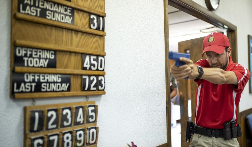 Lead Senior Firearms instructor at Georgia Firearms and Security Training Academy, Apollos Stanek, leads an exercise on how to clear a room at Calvary Baptist Church in New Stanton, Pa., on Friday, June 22, 2018. Representatives from 13 area churches got tips last week on proper handling of guns in the event any of their congregations faces a deadly intruder. In an age when any house of worship might become a gunman's target, the 17 men who gathered at Calvary Baptist Church in New Stanton practiced the best grip and stance to use when aiming a handgun. (Carolyn Rogers/Pittsburgh Tribune-Review via AP)