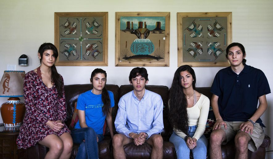This June 11, 2018 photo, from left, Tiffany Holt, 20,, Sophia Holt, 19, Seth Holt, 16, Sabrina Holt, 17, and Max Holt, 19, pose for a photo at their home in Naples, Fla. The siblings have started a GoFundMe asking for help with funeral, medical and general expenses after their father, Robert, passed away from cancer on May 29. The siblings worked jobs and put off going to college to help their father during his illness. (Nicole Raucheisen/Naples Daily News via AP)