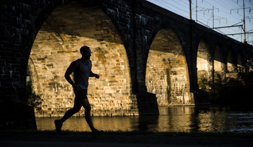 In this Wednesday, Oct. 4, 2017, file photo, a man runs along the Schuylkill River on Kelly Drive in Philadelphia. (AP Photo/Matt Rourke)
