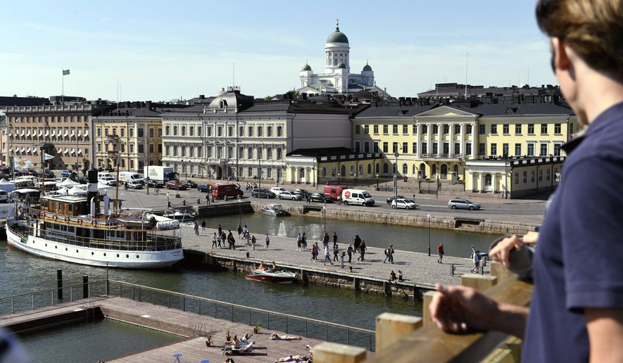 A view of the Market Square and the Presidential palace, in Helsinki, Finland, Thursday, June 28, 2018. Russian President Vladimir Putin and U.S. President Donald Trump will hold a summit in Helsinki on July 16, the Kremlin and the White House announced Thursday. (Onni Ojala/Lehtikuva via AP)