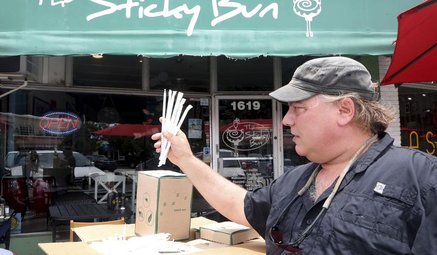 """Buddy Sparrow with the Deerfield Beach Island Groups delivers paper straws to the Sticky Bun in Deerfield Beach. The restaurant never uses plastic straws or polystyrene take-out materials. They are participating in a city-wide """"Strawless Summer"""" effort. Plastic awareness - and the urge to reduce the use of it - is growing in South Florida. (Mike Stocker/South Florida Sun-Sentinel via AP)/South Florida Sun-Sentinel via AP)"""