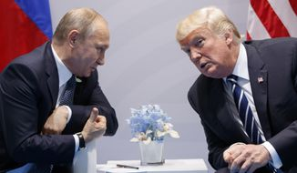 In this Friday, July 7, 2017, file photo U.S. President Donald Trump meets with Russian President Vladimir Putin at the G-20 Summit in Hamburg.  The Kremlin and the White House have announced Thursday June 28, 2018, that a summit between Russian President Vladimir Putin and U.S. President Donald Trump will take place in Helsinki, Finland, on July 16. (AP Photo/Evan Vucci, FILE)