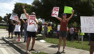 In this file photo, protesters rally against the practice of separating children from their parents and families being kept at the Broward Detention Center in Pompano Beach, Fla., Thursday, June 28, 2018. Carline Jean/South Florida Sun-Sentinel via AP) **FILE**