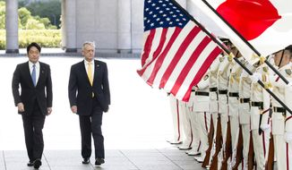 U.S. Defense Secretary Jim Mattis, second from left, with Japanese Defense Minister Itsunori Onodera reviews an honor guard before their meeting at Defense Ministry in Tokyo Friday, June 29, 2018. (Tomohiro Ohsumi/Pool Photo via AP)