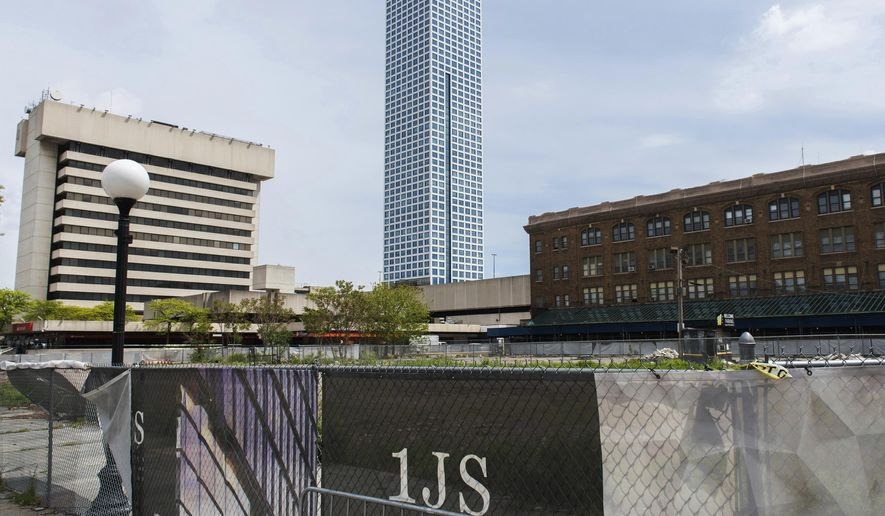 "FILE - This May 8, 2017 file photo shows the lot where One Journal Square, a twin-tower residential building in New Jersey championed by Jared Kushner, was to be constructed in Jersey City, N.J. A federal lawsuit filed Wednesday, June 27, 2018, by the Kushner Cos. claims Jersey City ""put politics over principle"" when it broke a contract with developers over the planned One Journal Square project. Democratic Mayor Steven Fulop publicly opposed granting tax breaks to the project before his November re-election and there have been protests at another Kushner-owned building in this heavily Democratic city. (Reena Rose Sibayan/The Jersey Journal via AP, File)"