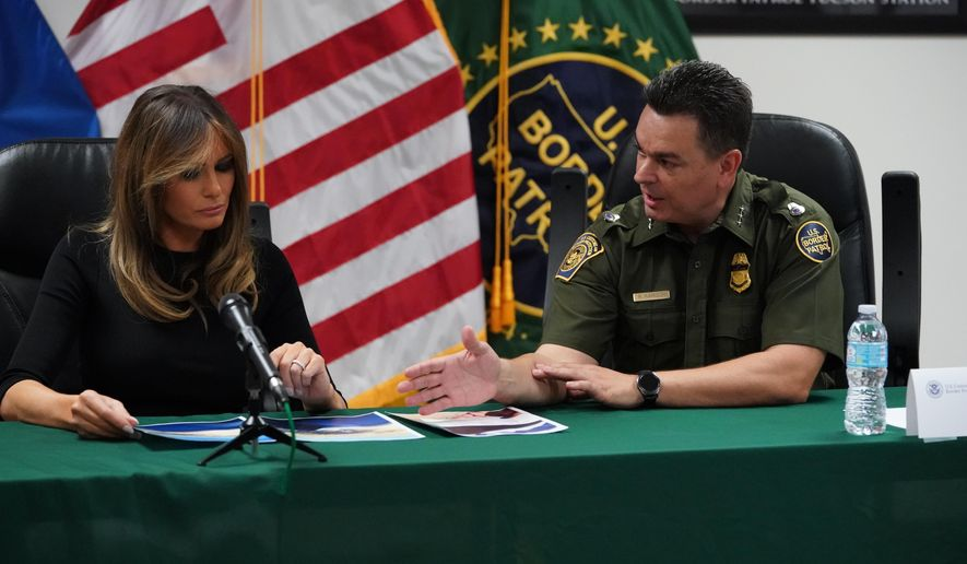 First lady Melania Trump talks with Rodolfo Karisch, Chief Patrol Agent, Tucson Sector Border Patrol, as she visits a U.S. Customs border and protection facility in Tucson, Ariz., Thursday, June 28, 2018. (AP Photo/Carolyn Kaster)