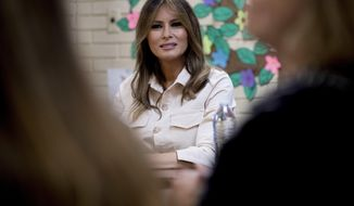 In this June 21, 2018, photo, first lady Melania Trump visits the Upbring New Hope Children Center run by the Lutheran Social Services of the South in McAllen, Texas. She is planning another visit to immigration centers housing migrants who have been apprehended at the U.S.-Mexico border. (AP Photo/Andrew Harnik)