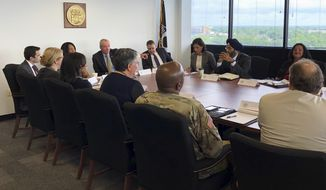 New Jersey Gov. Phil Murphy, pointing at center left, meets with members of his Cabinet to review state government shutdown procedures ahead of Saturday's deadline to enact a balanced budget, Thursday, June 28, 2018, in Trenton, N.J. Murphy and the Democrat-led Legislature are clashing over how much to raise taxes to pay for a bigger pension payment, a higher transit subsidy and a boost to school aid. (AP Photo/Mike Catalini)