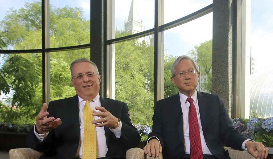 The two newest members of a top Mormon governing panel, Ulisses Soares, left, and Gerrit W. Gong, right, speak on Thursday, June 28, 2018, in Salt Lake City, during their first media interviews since being selected to the religion's Quorum of the Twelve Apostles earlier this year. Soares and Gong made history by becoming the first-ever Latin-American and the first-ever person of Asian ancestry on the previously all-white top leadership panel that help make policy decisions for The Church of Jesus Christ of Latter-day Saints. (AP Photo/Rick Bowmer)